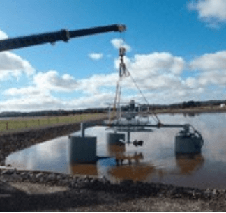 crane lifting aerator into place