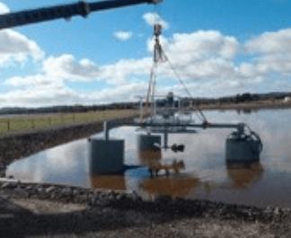 crane lifting aerator into place